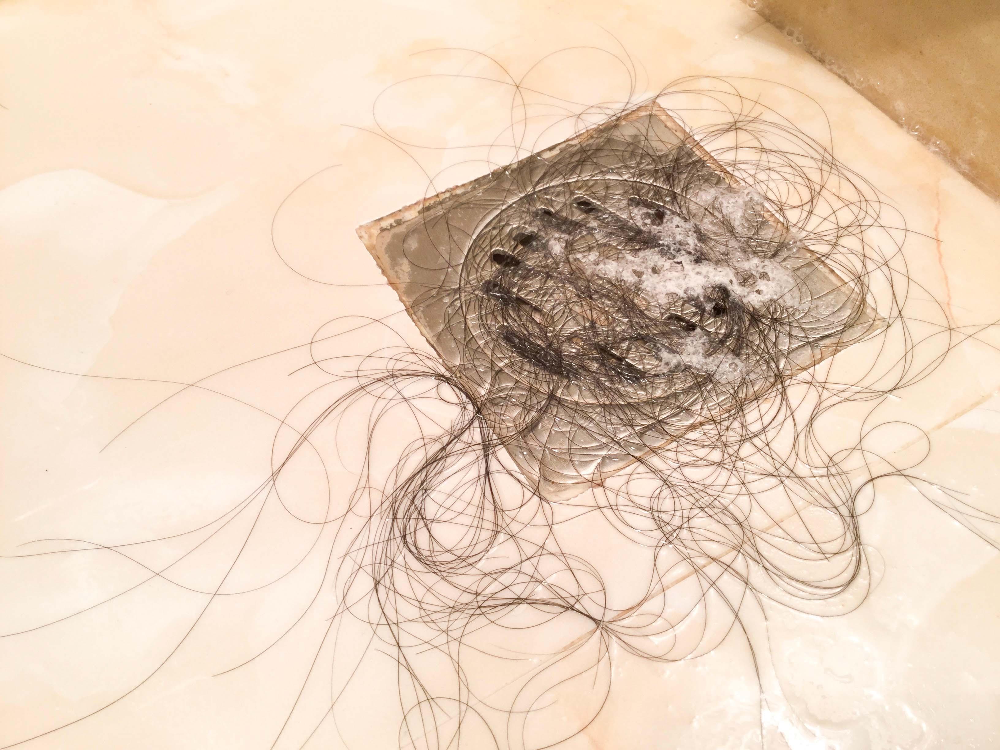 hair clogging drains