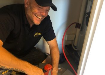 plumber clearing drains